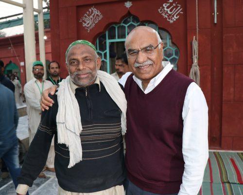 young man greeting with Dr Muhammad Amjad Saqib